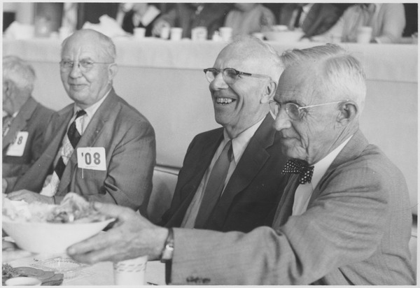 Class of 1908 alumni chatting at a reunion banquet, ca. 1958