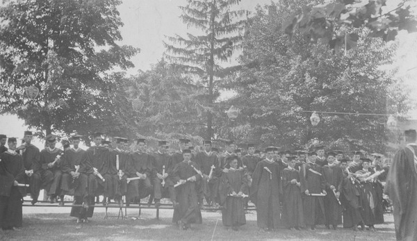 Students outside during commencement, ca. 1913