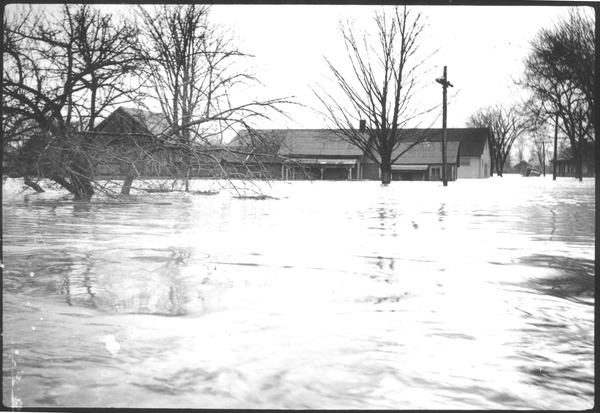 Flooded buildings and street, March 1936