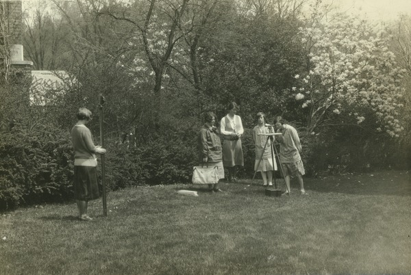Students surveying on the campus lawn, ca. 1922