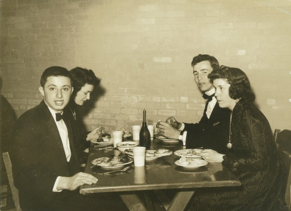 Kirby Hayes and Luther Gare dining with friends, 1942