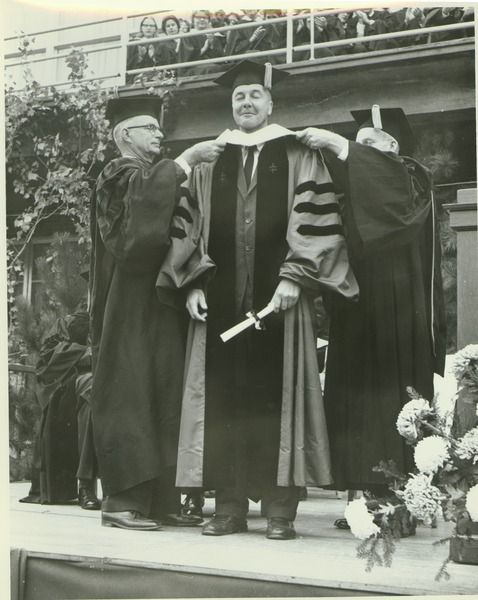 Calvin Plimpton at his hooding ceremony during the Centennial Convocation, October 4, 1962