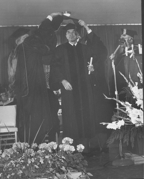 Glenn Seaborg at his hooding ceremony during the Centennial Charter Day convocation, April 29, 1963