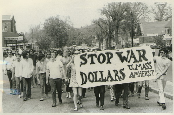 Students march through Amherst, ca. 1970