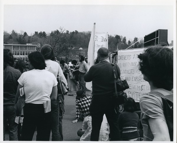 Board of Trustees fee increase demonstration: protestors listening to a speaker in front of the Whitmore Administration Building, April 15, 1976