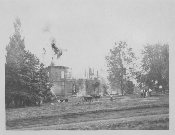 Chemistry Building (also known as College Hall) in flames, Massachusetts       Agricultural College, ca. 1922