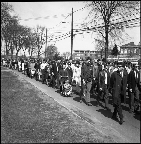Memorial march for Martin Luther King., Jr., led by Linus Pauling: Marchers on the UMass Amherst campus, walking along North Pleasant Street             toward town: , April 9, 1968
