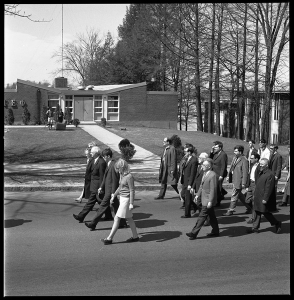 Memorial march for Martin Luther King., Jr., led by Linus Pauling: Marchers across the UMass Amherst campus, Pauling in front, proceeding down             North Pleasant Street toward town, Tau Epsilon Phi fraternity House in background: , April 9, 1968