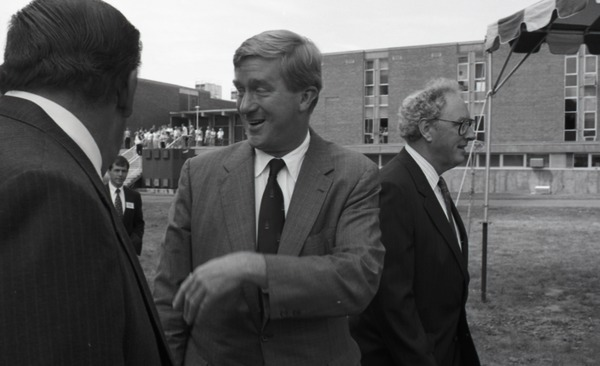 Ceremonial groundbreaking for the Conte Center: unidentified man chatting with             Gov. William Weld, Richard O'Brien in background, July 30, 1991