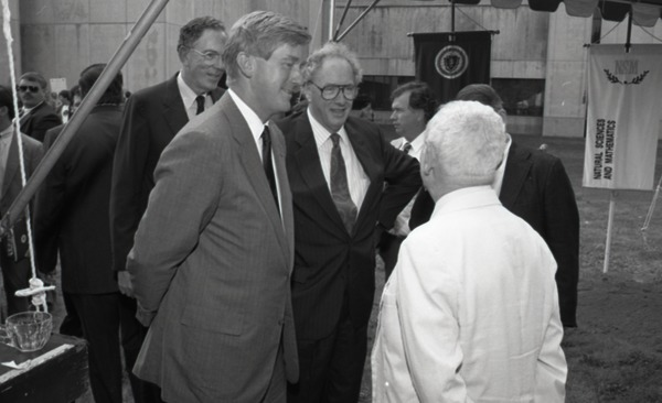Ceremonial groundbreaking for the Conte Center: Gov.             William Weld and Provost Richard O'Brien chatting with Richard Stein (l. to r.), July 30, 1991