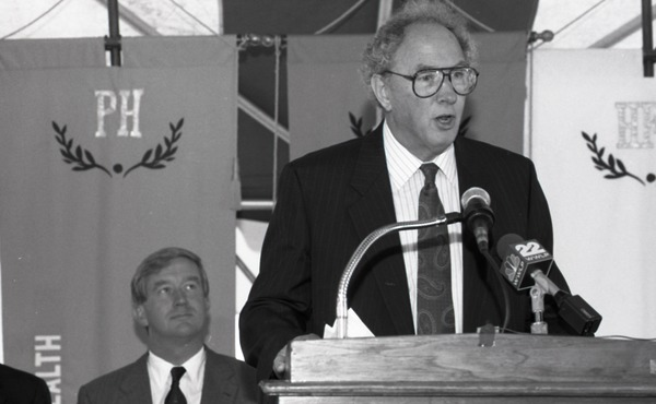Ceremonial groundbreaking for the Conte Center: Provost Richard O'Brien at             the podium (Gov. William Weld seated in the background), July 30, 1991